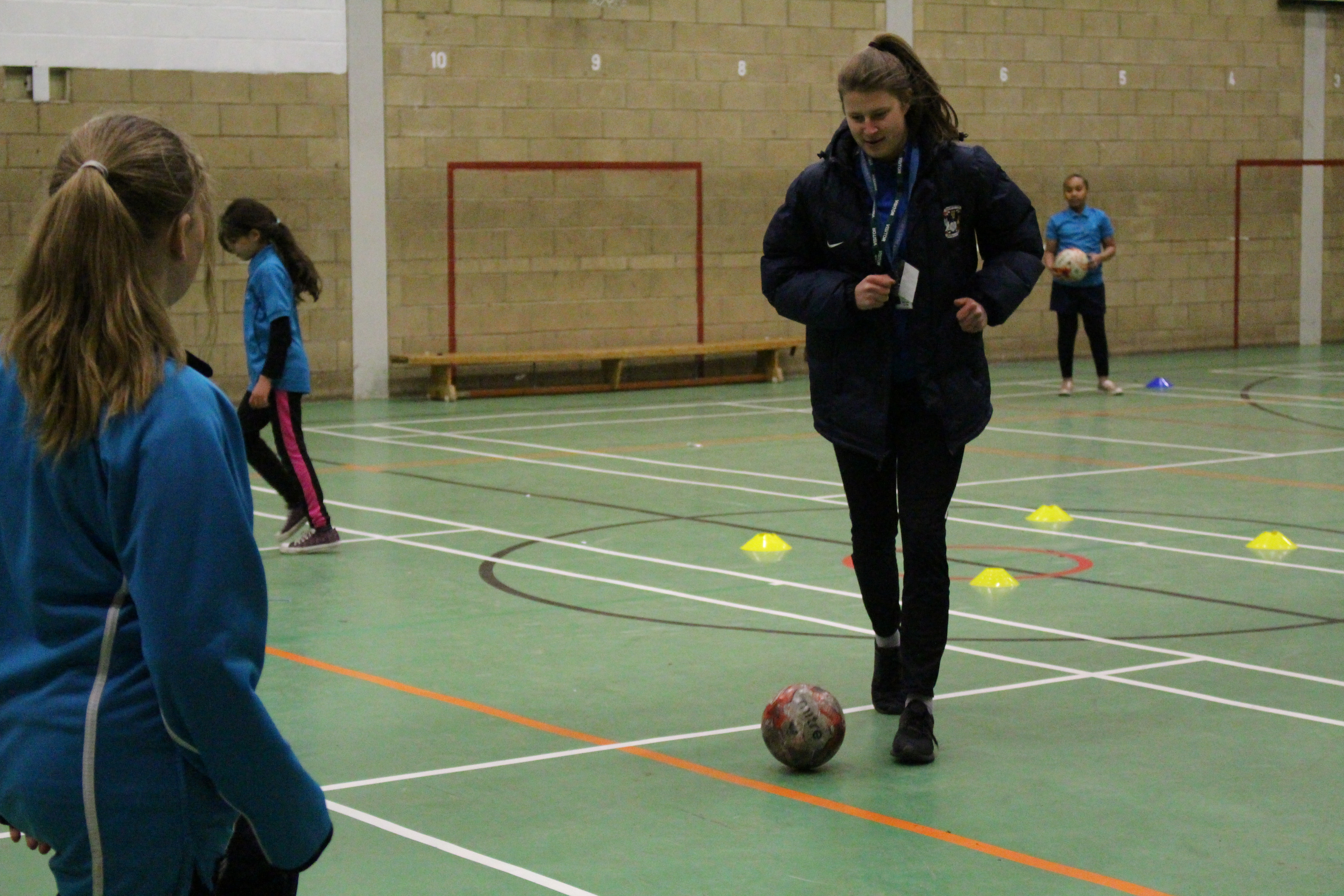 CCFC Football Development Officer coaches student