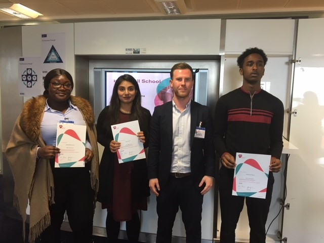 Students presented with certificate from Matt Matthews of Barclays and Mark Freeman from Turner & Townsend.